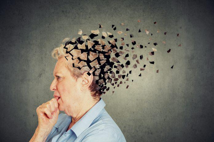Senior woman losing parts of head feeling confused as symbol of decreased mind function.
